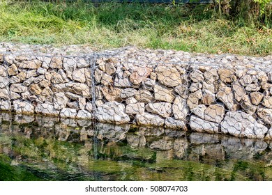 stones in a grid for strengthening river banks