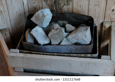 Stones for heating the sauna inside the bathhouse