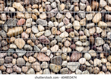 Stones with an iron grid, part of a protective decorative structure