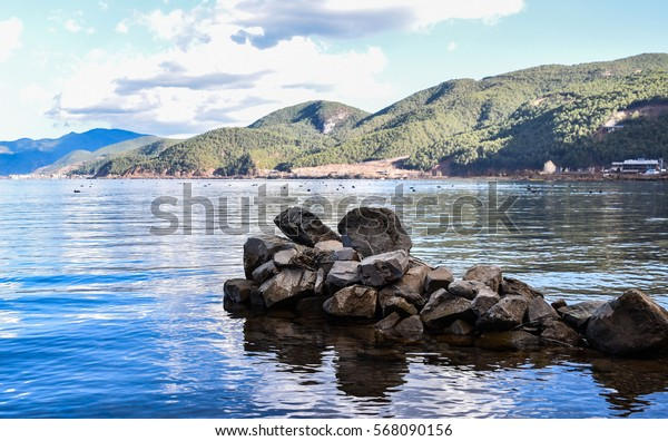 Stones and the lake.