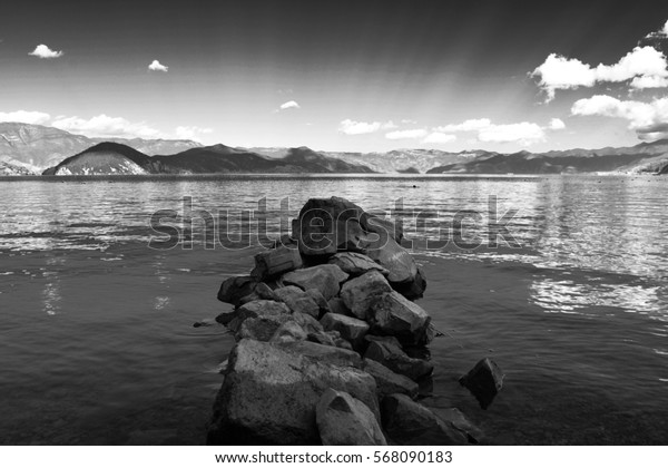 Stones and the lake in black and white.