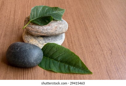 Stones and Leaves against the Wooden Surface