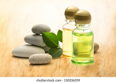 Stones, leaves and shampoo bottles on stained paper