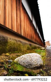 The stones are longer be outside the wood fence of traditional ancient house in Japan