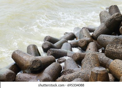 Stones at Marine drive,The tetrapods, made of concrete. Its main function is to dissipate the strong waves that continuously lash the shore. Marine Drive/Queen's necklace,Mumbai, India.