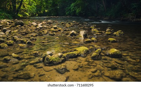 Stones with moss in the small mountain river