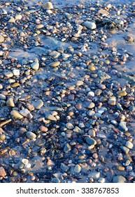 Stones on beach evening light