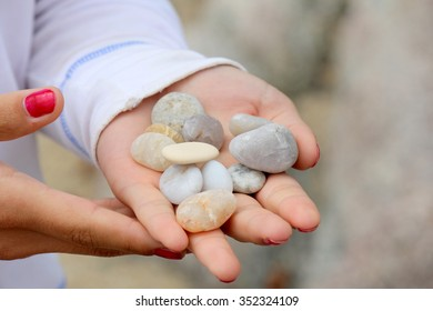 Stones are on the hand