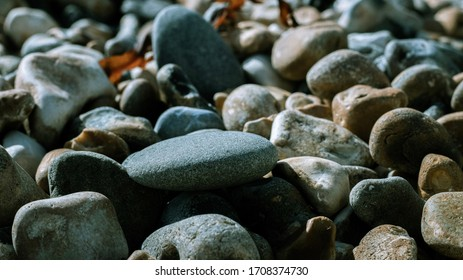 Stones on a pebble beach in Brighton. Beach stones. Pebbled beach. Grey stones background. Background with stones.