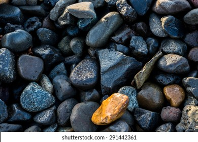 Stones on the shore of Hood River, Oregon with dew drops