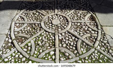 Stones paved street mosaic in the old town of Labin - Istria, Croatia (Kamenjem poploceni mozaik ulice u starom gradu Labinu - Istra, Hrvatska) - Shutterstock ID 1695048679