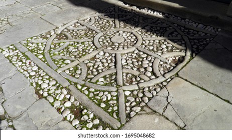 Stones paved street mosaic in the old town of Labin - Istria, Croatia (Kamenjem poploceni mozaik ulice u starom gradu Labinu - Istra, Hrvatska) - Shutterstock ID 1695048682