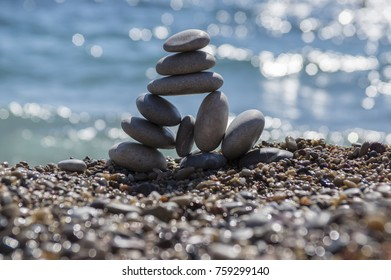 Stones and pebbles stack, harmony and balance, One big pyramid stone cairn on seacoast