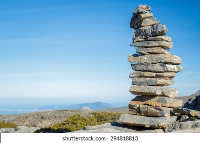 Stones pile at the mountain with blue sky at background