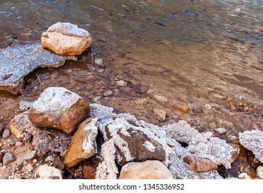 Stones and salt of the Dead sea beach. Israel