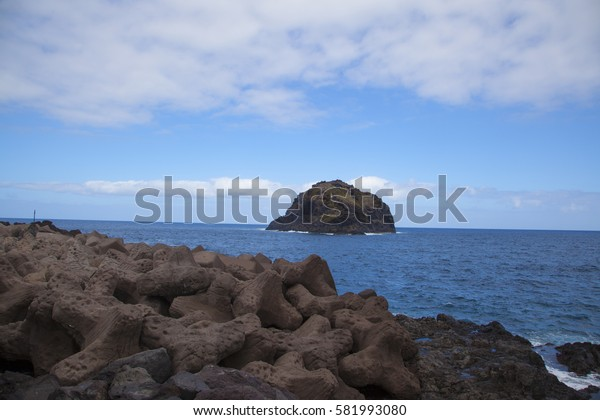 stones in the sea near the island