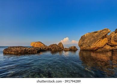 stones in sea on the beach Porto Zoro, Zakynthos, Greece