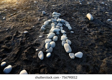 Stones in shape of man at Reynisfjara black sand beach near Vik