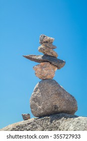 Stones stack against blue sky at the Monte Foia in Monchique, Portugal
