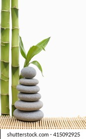 stones stack in balance with bamboo grove on w mat