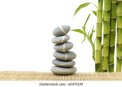 stones stack in balance with bamboo grove on bamboo stick straw mat