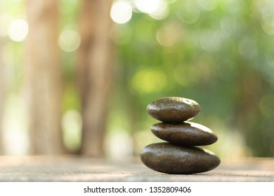 Stones stacked are balance on the table for natural spa concept.
