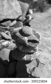 Stones stacked on a California beach. Black and White.