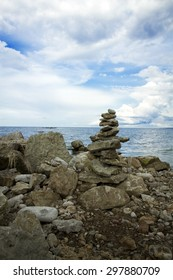 stones stacked on each other on the background of the ocean