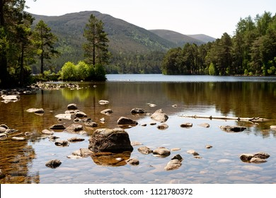 Stones standing from the water in the lake in the Cairngorms National Park, Scotland