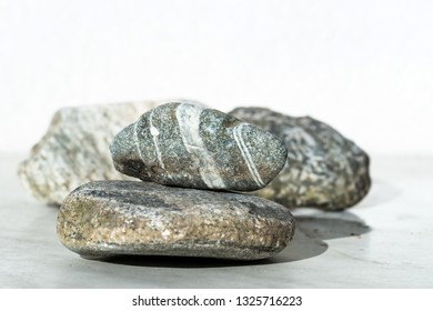 stones in stripes on a light background in a composition