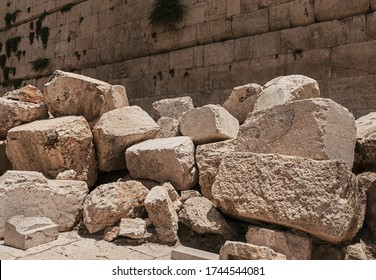 stones thrown by the romans from the second temple to the street below after the destruction of the temple in 70 CE with the Western Wall in the background - Shutterstock ID 1744544081