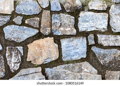 stones thundering the wall
