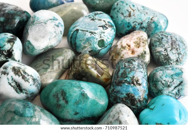 Stones turquoise crystals on a white  background.