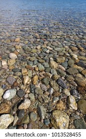 Stones under the blue sea water