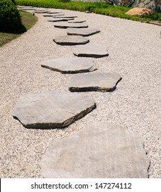 Stone's way in the Japanese garden in sunny day