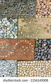 The stones were arranged neatly. To decorate the garden stone background.Concrete tile,decorative floor pattern of a gravel stone.Use for architecture