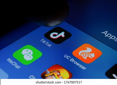 Stone/UK-June 30 2020: TikTok WeChat apps ban in the US and India. Finger pointing at them. Chinese apps that were banned in America and India due to security concerns and data harvesting.
