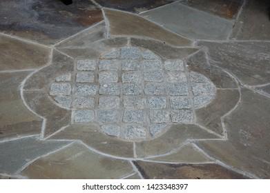 Stonework flagstone and cobblestone quatrefoil design