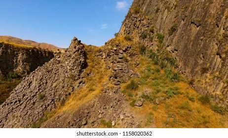 Stony basalt rocks and deep gorge, Armenia landscape, ecotourism, travel