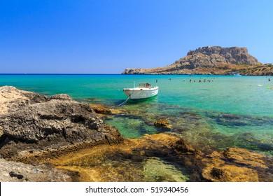 The stony beach at Rhodes Charaki, golden sand