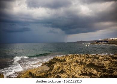 Stony beach in Sliema, Malta