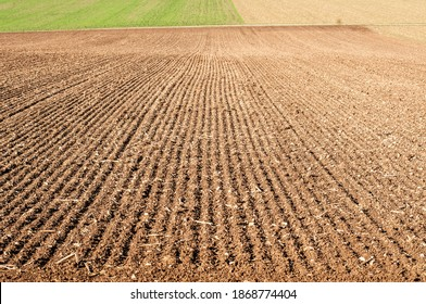 a stony field in swabian alb in germany with sowing furrows in lines