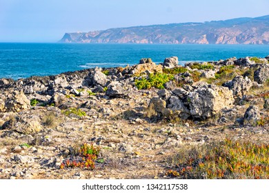 Stony ocean shore. Portugal, Europe.