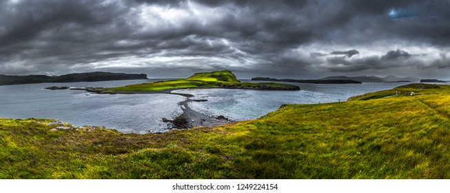 Stony Sandbank To Sunlit Green Island At Low Tide On The Isle Of Skye In Scotland