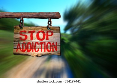 Stop addiction educational motivational phrase sign on old wood with blurred background