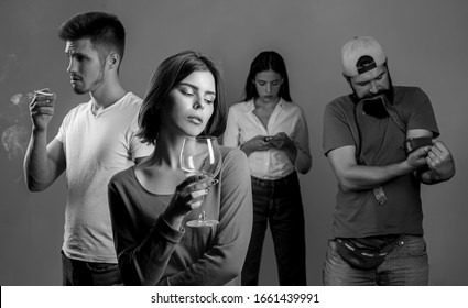 Stop alcohol addiction. Addictive group including alcohol cigarettes and drugs. Hard drugs and alcohol addict. Serious sad woman having alcohol addiction. Sad teenage girl with social problems.