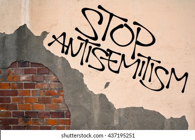 Stop Antisemitism - handwritten graffiti sprayed on the wall, anarchist aesthetics. Appeal to fight against religious prejudice, hatred, violent attacks and genocide