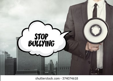 Stop bullying text on speech bubble with businessman and megaphone