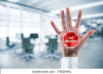 Stop bureaucracy concept. Businessman hand with stop street sign and text Stop Bureaucracy.