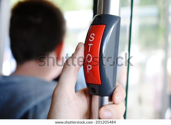 Stop button in the bus